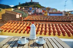 Coffee with view to Bosa village, Sardinia, Italy Royalty Free Stock Photography