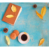 Coffee, vintage book, oatmeal cookies and autumn leaves on wood background - relax or retirement concept with free text space. Hot coffee, vintage book, oatmeal Royalty Free Stock Photo