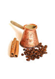 Coffee in vintage copper turkish coffee pot (cezve or ibrik) , coffee beans and cinnamon sticks on white. Coffee in vintage copper turkish coffee pot stock images
