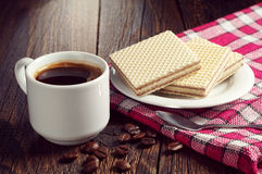 Coffee and wafers Stock Photos