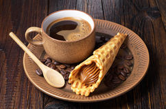Coffee and waffle cones Stock Photos