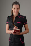 Coffee waitress in retro uniform. Waiting to take order Royalty Free Stock Images