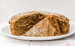 Coffee and Walnut Fudge Cake. On a white plate and background Stock Photography