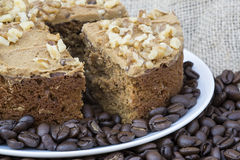 Coffee and walnut layer cake with cup of coffee Royalty Free Stock Photography