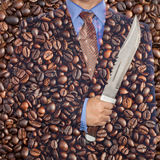 Coffee war . Businessman holding knife on coffee Royalty Free Stock Image