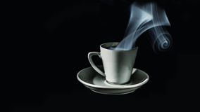Coffee. The coffee was steaming in a white cake with a plate royalty free stock photo