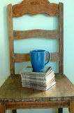 Coffee Weekend. Home Interior, CD's sitting on an old chair with a blue mug of coffee Stock Image