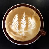Coffee white art three leaves Royalty Free Stock Photo