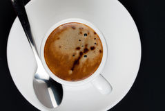 Coffee in white on black Stock Image