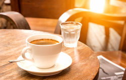 Coffee,White Coffee Mug,Glass water,Wooden table. Stock Images