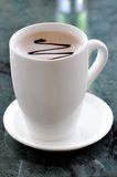 Coffee. A white cup of coffee Royalty Free Stock Image