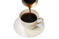 Coffee in a white cup. Coffee flows in a white cup on a saucer Royalty Free Stock Images