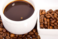 Coffee in white cup. Cup of coffee and coffee beans  on white background Royalty Free Stock Images