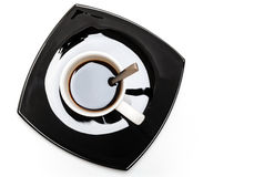 Coffee in white cup on black saucer Royalty Free Stock Photo