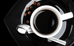 Coffee in white cup on black saucer Stock Photo