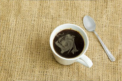 Coffee in a white cup on brown Stock Images