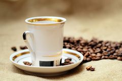 Coffee in white cup. On burlap background Royalty Free Stock Photography