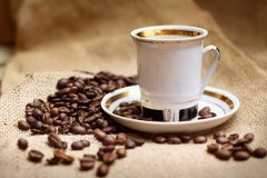 Coffee in white cup. On burlap background Royalty Free Stock Photos