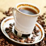 Coffee in white cup. On burlap background Stock Photo