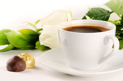 Coffee in white cup with candies and flowers Royalty Free Stock Photos