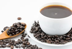 Coffee in white cup and coffee beans Royalty Free Stock Photo
