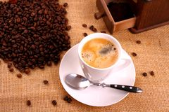 Coffee in white cup and coffee mill Royalty Free Stock Images
