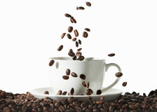 Coffee. White cup of coffee with roasted beans on white backgrou Stock Photos