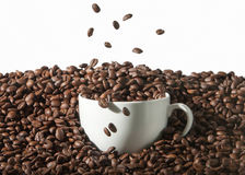 Coffee. White cup of coffee with roasted beans on white backgrou Stock Photography