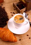 Coffee in white cup and croissant Stock Images