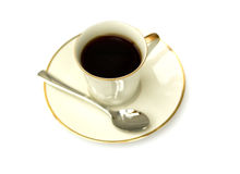Coffee in white cup isolated. Coffee in retro cup with golden edge isolated on white background royalty free stock photos