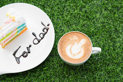 Coffee in white cup with rainbow cake with word Royalty Free Stock Photo