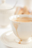 Coffee in white cup with spilled drop Royalty Free Stock Photography
