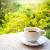 Coffee in a white cup on the table. Stock Photography