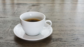 Coffee in white cup on table Royalty Free Stock Image