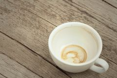 Coffee white cup is then used on a background of wooden Royalty Free Stock Photography