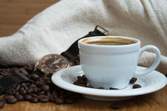 Coffee in white cup and watches. Coffee in white cup and old watches Royalty Free Stock Photography
