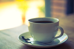 Coffee in white cup on wood table Stock Photography