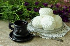 Coffee and white marshmallows Stock Photo
