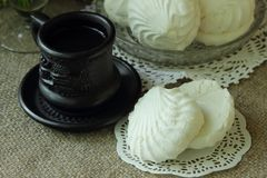 Coffee and white marshmallows Stock Image