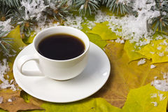Coffee in a white mug and snow Royalty Free Stock Image