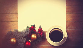 Coffee and white paper near branch with christmas toys Stock Images