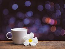 Coffee and white plumeria flowers Stock Photography