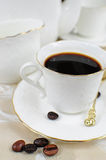 Coffee in white porcelai cup with coffee beans Royalty Free Stock Images
