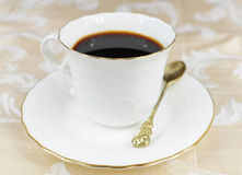 Coffee in white porcelain cup Stock Images