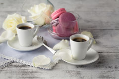 Coffee and white roses on table Royalty Free Stock Photo