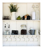 Coffee white shelves. On a white background Royalty Free Stock Photos