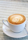 Coffee on white table in cafe Stock Photography