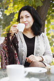 Coffee and a woman Stock Image