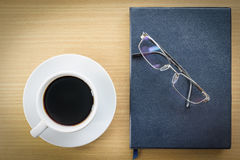 Coffee on wood table and glasses Stock Photo
