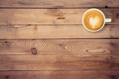Coffee on wood table texture with space